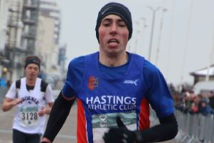 Gary Foster crosses the line to finish third in last year's Hastings Half Marathon. Picture courtesy Roberts Photographic