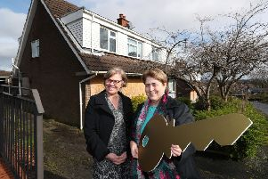 Tracy Meharg, permanent secretary of the Department for Communities (DfC), has handed the keys of 59 former MOD homes at Mountview Drive and Skyline Drive, Lisburn to Clare McCarty from Clanmil Housing. Clanmil will refurbish them into 30 social homes for families on the social housing waiting list and 29 affordable homes for sale to those wanting to get on the property ladder.