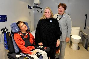 (From left) Alfie and Samantha Buck with Gill Buchanan Swan Walk centre manager in the new Changing Place facility