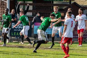 Tommy Wood (centre) celebrates his late equaliser against Brightlingsea Regent. Picture by Chris Neal.
