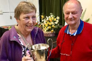 Lyn Southgate receives her trophy from Richard Tabor