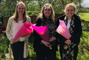 Chichester University teacher training students Jessica, Charlotte and Lauren who gave Ashington CE Primary School's prayer garden a new lease of life SUS-190105-140011001