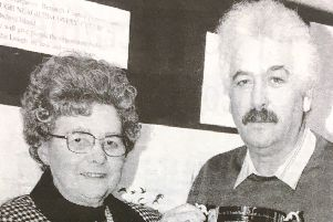 Miss Nina Murdoch presents the Shaftesbury Cup to Errol Bailie in 1992 to be competed for at a clay pigeon shoot in aid of Lough Neagh Rescue Service
