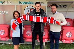 Ashley is pictured with Operations Director Kelly Derham and Director of Football Selim Gaygusuz. Picture courtesy of Crawley Town
