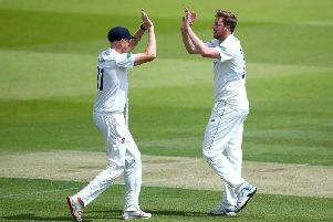 Ollie Robinson celebrates one of his ten wickets at Lord's with Luke Wells / Picture by Getty Images
