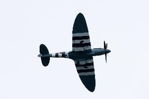 A Supermarine Spitfire in D-Day markings'Picture: Duncan Shepherd
