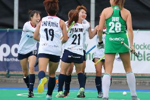 Korea celebrate scoring a goal against Ireland in their eventual 3-1 win