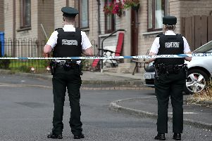 Police at the scene of the murder investigation at Coulson Avenue, Lisburn.  Photo: Press Eye