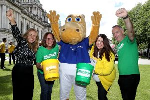 Mark Tumelty (right), branch manager of Ulster Bank in Lisburn, celebrates the charity campaign success along with (l-r) Q Radio's Cate Conway, Joanne Young (Macmillan). Henry Hippo and Michelle Byrne from AWARE.