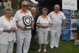 The Pagham open fours winners with the club president