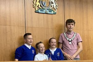 Worthing youth mayor Jimi Taylor with the winning team from Rustington Community Primary School
