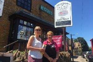 Sisters-in-law Lucy (left) and Jenni Smith with a replacement Thomas' Fund collection tin outside Duston Village Bakery after the break-in