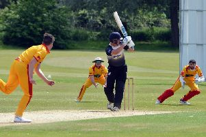 Action from June's game between Horsham and Roffey. Picture by Steve Robards