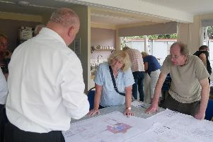 Architect Bill Bayliss talks to Sandra Houghton and Ray Colverwell about the proposed plans for St James' Hospital. Picture: Habibur Rahman