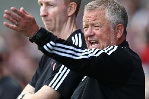 Chris Wilder and Alan Knill watch their Sheffield United team beat the Cobblers 2-0 on Saturday (Picture: Pete Norton)