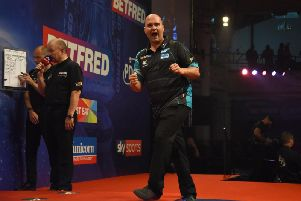 Rob Cross in action in the final. Picture by Chris Dean/PDC