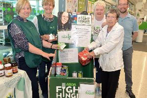 Pictured with the Craigavon area Foodbank donations trolley at Asda, Portadown, are from left, Angela Belshaw and Angela McVeigh, Craigavon Area Foodbank volunteers, Asda Community Champion, Elaine Livingstone, Philomena Dale, customer, (Portadown), and Martin Stevenson, Craigavon Area Foodbank manager.