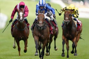 Battaash, centre, on his way to King George Stakes history / Picture by Getty Images