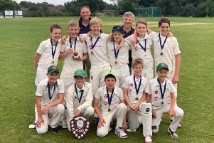 West Chiltington & Thakeham's victorious under-12s team with the Sussex Sussex Cricket Festival Shield