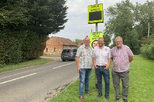 A 'cracking' donation: Daniel Fairburn, centre, of LJ Fairburn, which paid for the speed sign.