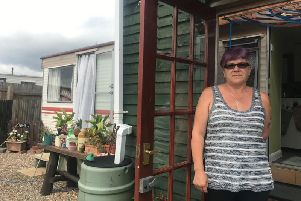 Sandra Marrows outside the static caravan she has called home since 2014.