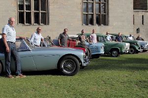 Members of the Guy of Warwick Society with classic cars at Warwick Castle. Photo by Guy of Warwick Society.