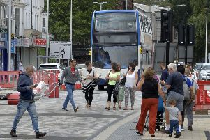Buses and pedestrians in Terminus Road, Eastbourne (Photo by Jon Rigby) SUS-190813-113559001