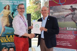 Capitol Theatre manager Nick Mowat receives his award from Jonathan Chowen SUS-190816-111027001