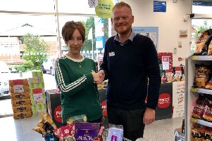 Heather Hawkes from Butterwick Baby and Toddler Group collects the donation from Lincolnshire Co-op.