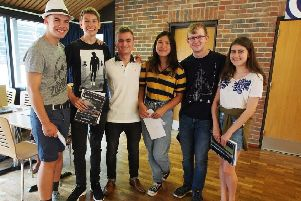 Beacon Academy students celebrating their GCSE results