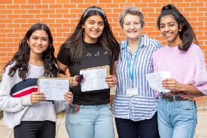 All smiles... Three QEGS pupils are pictured with outgoing heateacher Heather Payne.