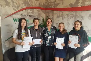 Students Zara Gartside, George Crook, Katherine Tomes, and Sarah Plowman with Katherine Cocker-Goring (Head of School), centre