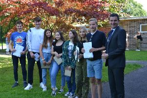 Photograph of Headteacher Mr Edward Rodriguez & students with their GCSE results.