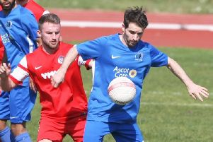 Heaths Jamie Taylor (right) bagged a double against rivals Loxwood. Picture by Derek Martin Photography