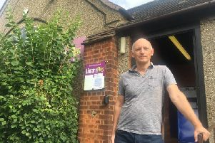 Friends of Abington Library vice chairman Martin Sawyer outside the under-threat library