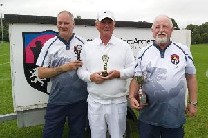 Bronze medallist Stuart Rodgers (left, and double national champion Pete Shaw with their coach and national award-winner Rick Smith (right) EMN-190919-095637002