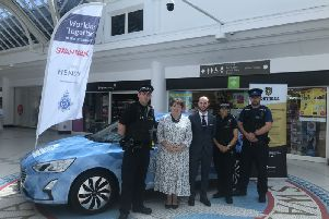 Gill and local policing team at the presentation of the sponsored police car earlier this year