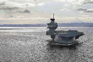 Britain's newest aircraft carrier has hit top speed as she tested her engines to the max in the North Sea. HMS Prince of Wales thundered through the sea at 25 knots as her diesel generators and gas turbines were pushed to full throttle during only her second week of trials. Picture: LPhot Alex Ceolin''