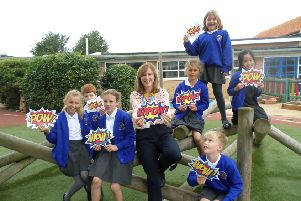Head of school Marie Smailes celebrating their Ofsted success with pupils
