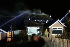 A firefighter at the scene in Newhaven. Picture: East Sussex Fire and Rescue Service