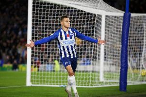 Brighton and Hove Albion's Leandro Trossard celebrates his opening goal against Norwich City at the Amex Stadium