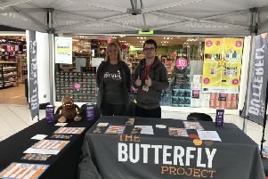 The Butterfly Project team in the centre celebrating Purple'Tuesday
