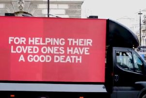 The Dignity in Dying campaign bus outside Parliament. Photo: Dignity in Dying.